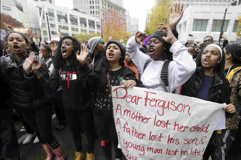 Protesters march in Seattle to demonstrate against a grand jury's decision. The peaceful march was a mix of students who walked out of schools and a coalition of clergy members.