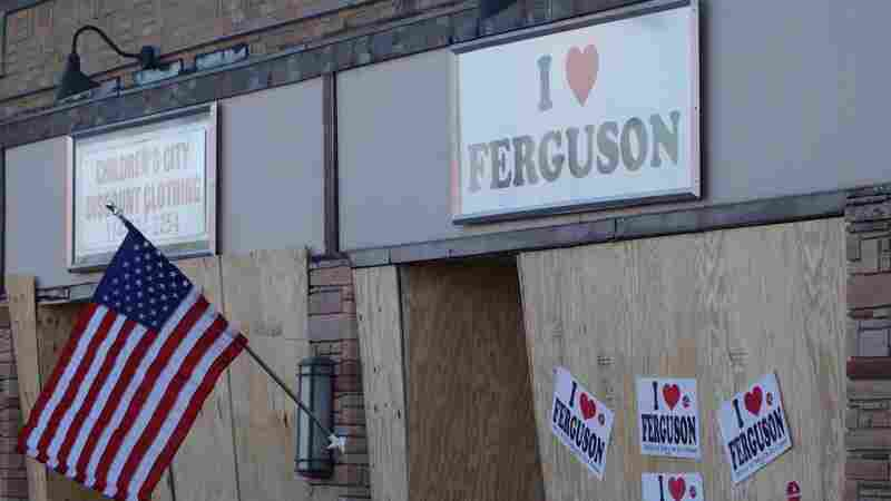 "A local business is boarded up in anticipation of another night of unrest in Ferguson, Mo., Tuesday. A day after people set fire to buildings in the city, President Obama said, ""I have no sympathy at all for destroying your own communities."""