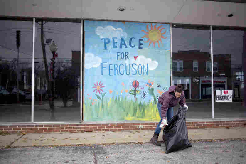 Jodi Wurm helps to clean up after violent protests damaged businesses in Ferguson.