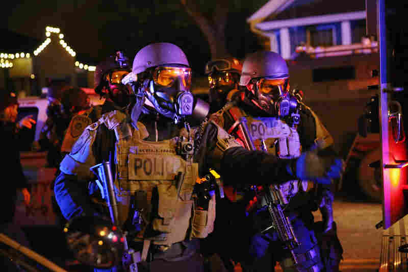 Police confront protesters after rioting broke out in Ferguson on Monday night. Ferguson has been struggling to return to normal after Brown was killed by Wilson on Aug. 9.