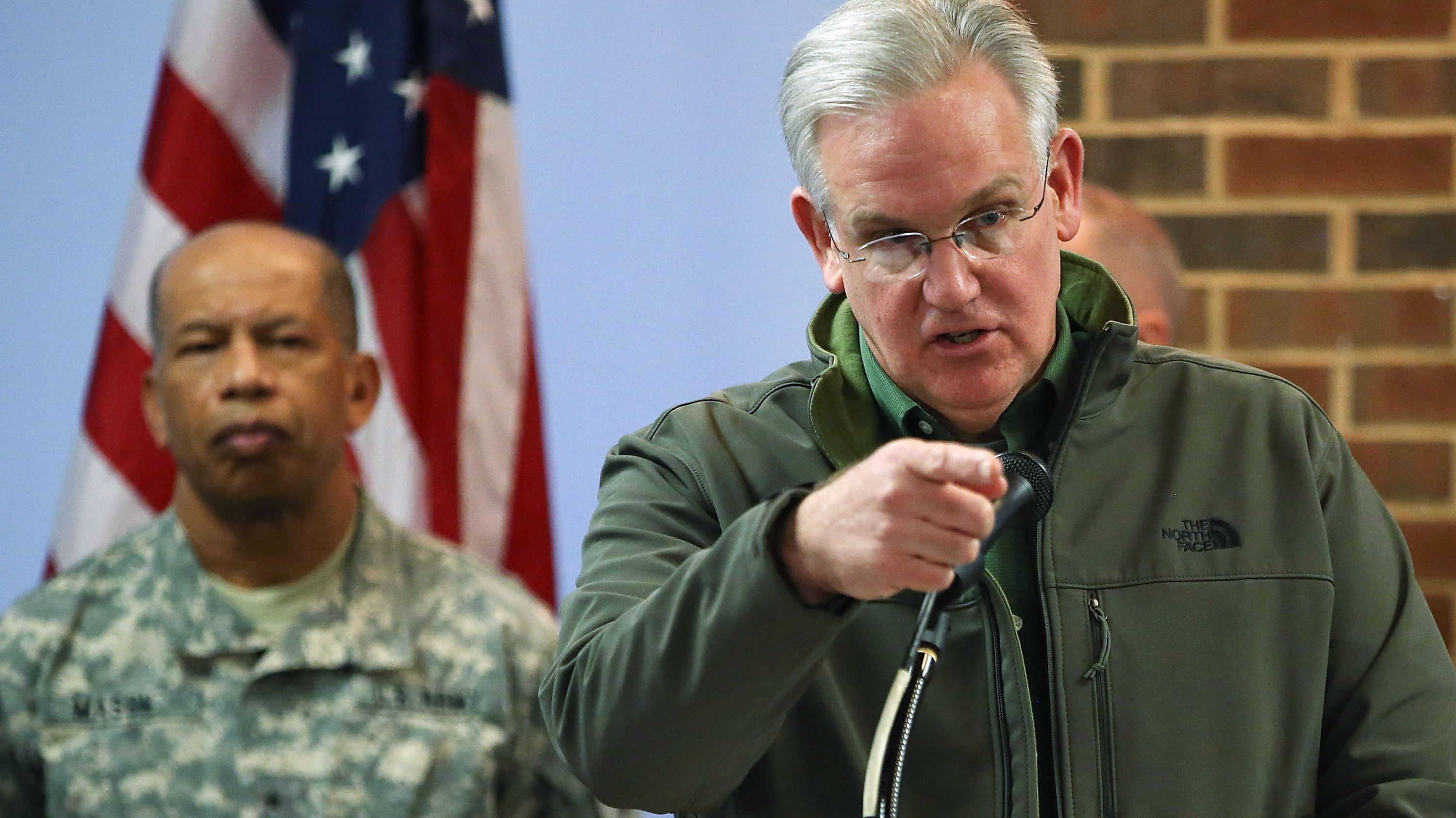 """Missouri Gov. Jay Nixon said that parts of Ferguson were """"a heartbreaking sight"""" Tuesday, with residents afraid to go outside."""