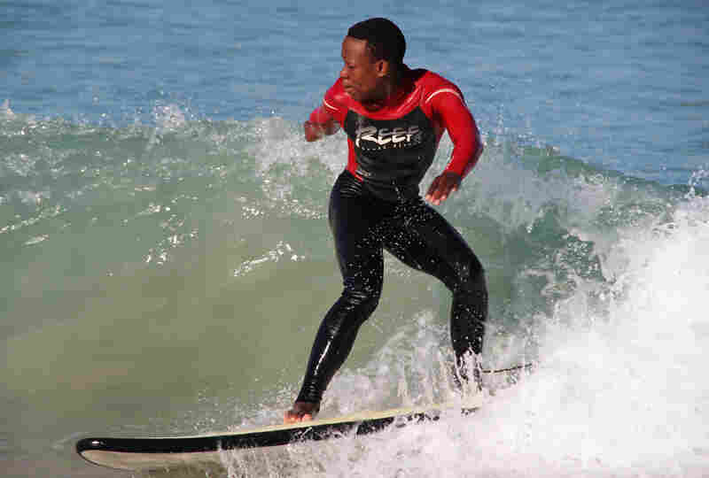 Mntanywa catches a wave at Monwabisi Beach.