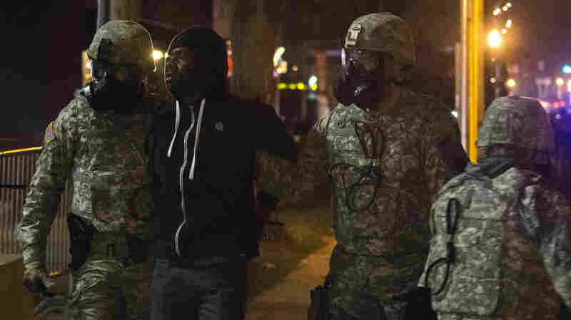 Members of the National Guard detain a protester in Ferguson, Mo., on Wednesday. More than 2,000 National Guard troops spread out across the St. Louis area to prevent another night of rioting and looting after a grand jury declined to indict officer Darren Wilson in the fatal shooting of 18-year-old Michael Brown.