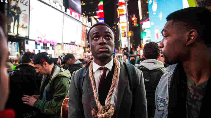 People protest Tuesday night in Times Square regarding the Ferguson grand jury decision to not indict officer Darren Wilson in the Michael Brown case.