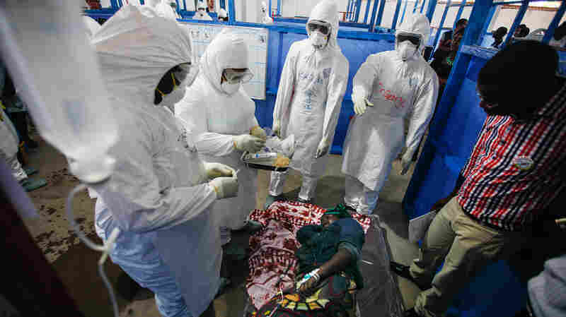 In a training session for health workers in West Africa run by WHO, Ebola survivors play the part of Ebola victims.