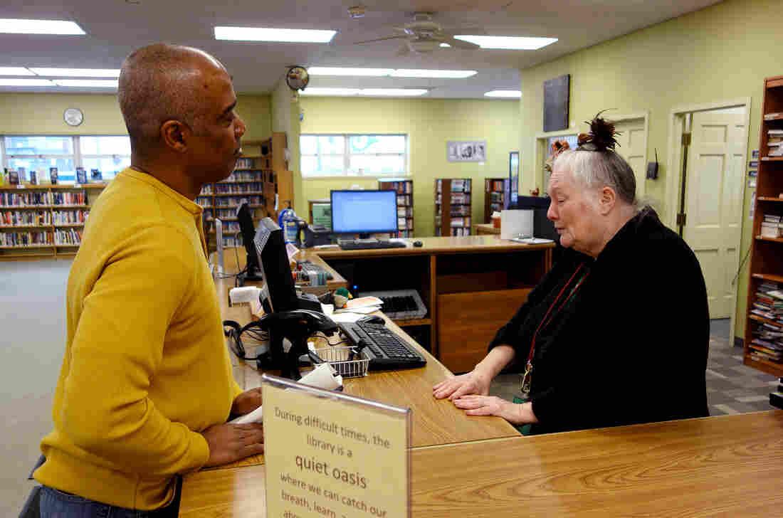 Library volunteer Jeanne Million talks with Ferguson resident Phillip Sampson at the Ferguson Public Library.