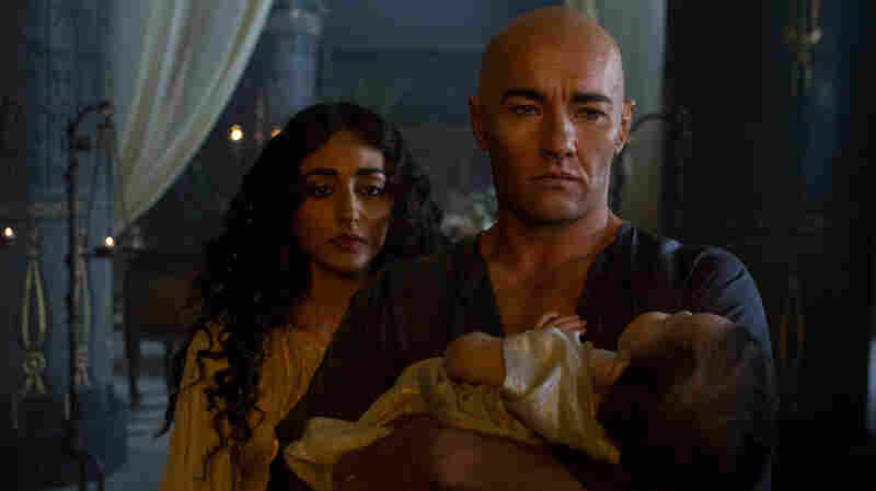 Rameses (Joel Edgerton) and his wife Nefertari (Goldshifteh Farahani) try to save their stricken child, a victim of one of the Plagues, in Exodus: Gods And Kings.
