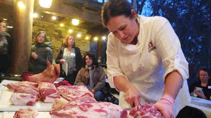 "Master butcher Kari Underly cuts into a hog during a ""Women in the Meat Business"" workshop in Chapel Hill, NC."