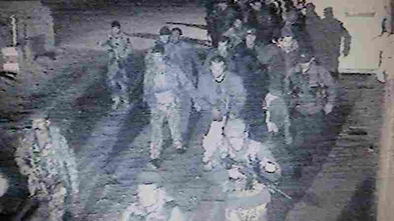 A closed circuit security camera shows Afghan security forces responding to an attack on a compound in Kabul, Afghanistan, on Thursday.