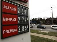 The lowest gas prices in years are seen on a fuel sign in Lawrence, Kan., on Wednesday. OPEC today decided to maintain current production levels, virtually ensuring continued low prices at the pump.