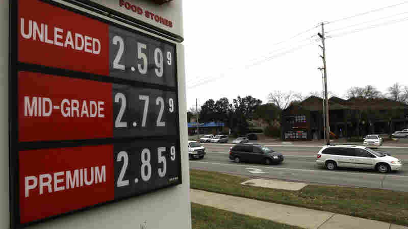 The lowest gas prices in years are seen Wednesday on a fuel sign in Lawrence, Kan. A day later, OPEC decided to maintain current production levels, virtually ensuring continued low prices at the pump.