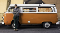 Wellington stands in front of a Volkswagen bus Sunday in Brooklyn, N.Y.