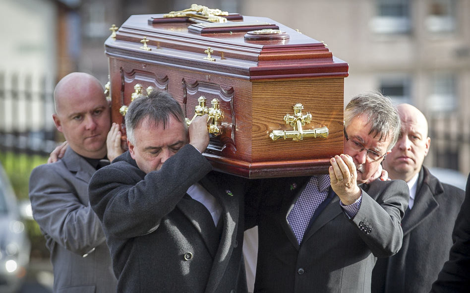 The remains of Brendan Megraw are carried to St. Oliver Plunkett Church in Belfast by his brothers Kieran (second left) and Sean (second right) on Nov. 14. The remains were found in a bog 36 years after Megrew was taken by the IRA. He was one of the many who died or disappeared during the decades-long Troubles between Protestant loyalists and Catholic republicans in Northern Ireland. (Liam McBurney/PA Photos/Landov)
