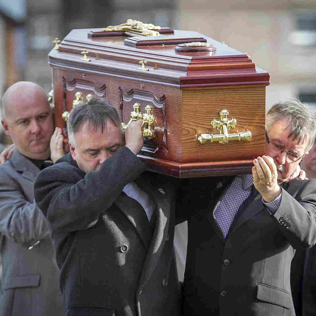 The remains of Brendan Megraw are carried to St. Oliver Plunkett Church in Belfast by his brothers Kieran (second left) and Sean (second right) on Nov. 14. The remains were found in a bog 36 years after Megrew was taken by the IRA. He was one of the many who died or disappeared during the decades-long Troubles between Protestant loyalists and Catholic republicans in Northern Ireland.