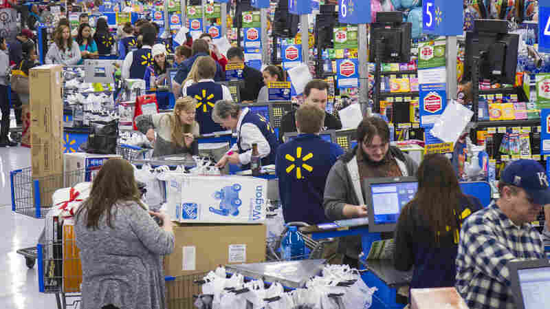 Customers in Bentonville, Ark., where Walmart's corporate headquarters are located, turn out for holiday shopping on Thanksgiving.