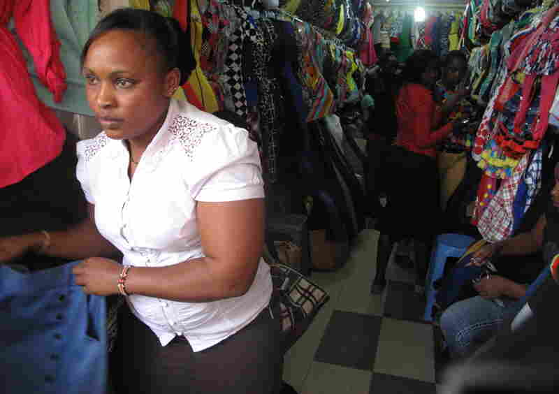 "Marianne Njambi looks out at the bus station where a public stripping two weeks ago has inspired copycat attacks. ""Since they started stripping girls,"" she says, ""I started fearing."""
