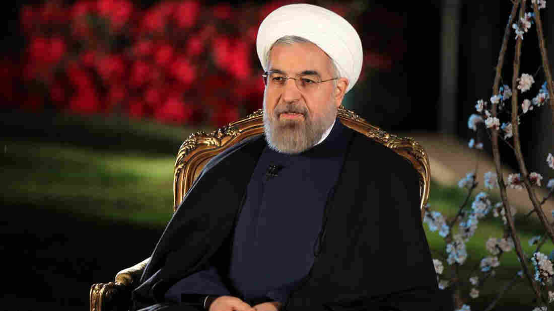 Iran's President Hassan Rouhani, shown in Tehran in March, supports the nuclear negotiations with the U.S. and other world powers. Iran is now receiving some $700 million a month in sanctions relief. Those watching the negotiations include former U.S. hostages in Iran, who have sought compensation for years.