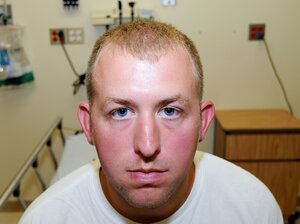 Ferguson police officer Darren Wilson, shown during his medical examination after he fatally shot Michael Brown, has resigned from the Ferguson Police Department, the AP reports. Wilson has been on administrative leave since the Aug. 9 shooting.