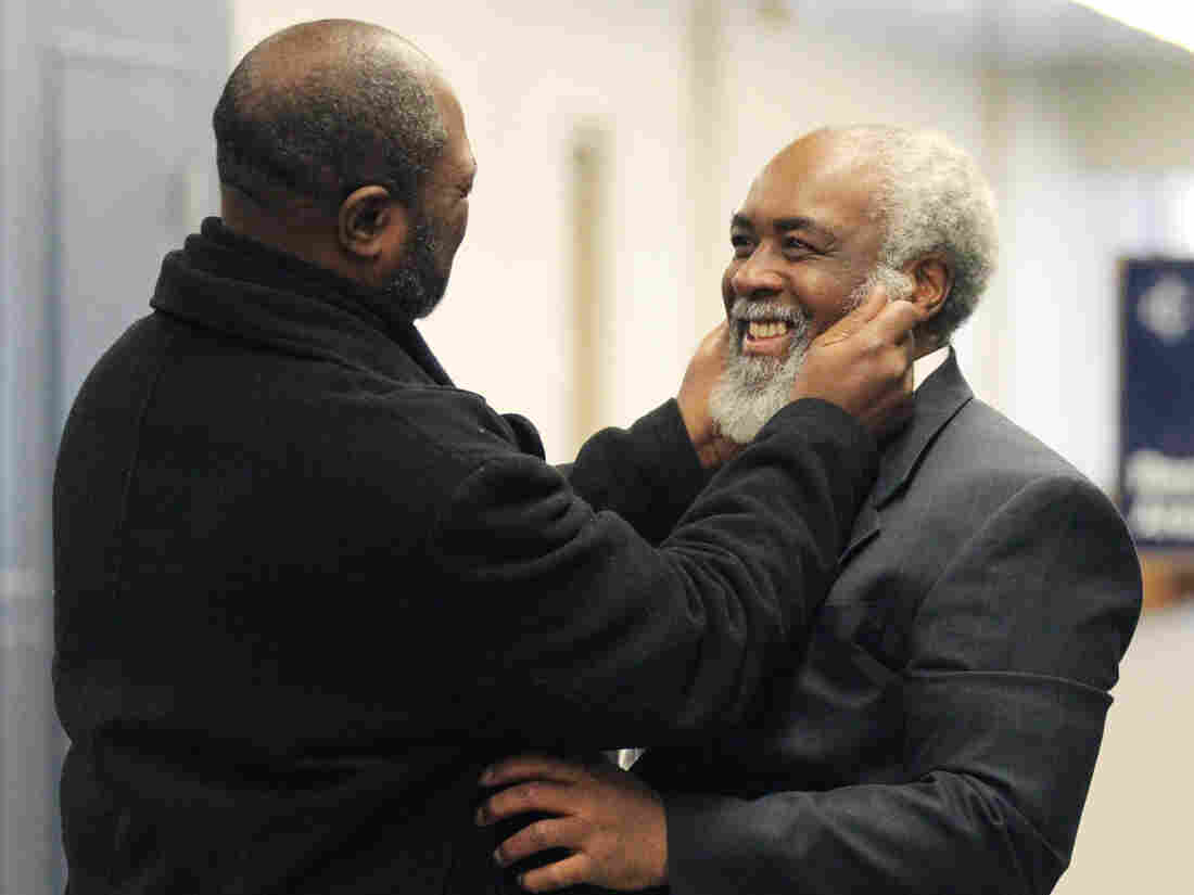 Kwame Ajamu grabs his brother Wiley Bridgeman's beard after his release in a gesture that dates from their boyhood.
