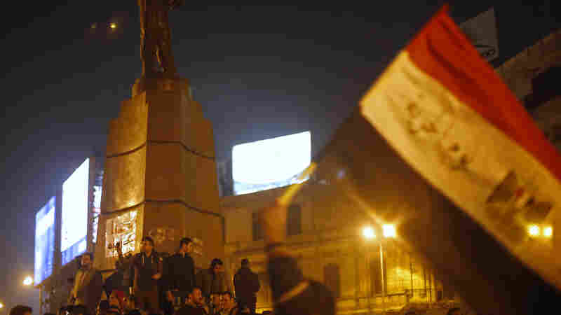 Anti-Mubarak protesters shout slogans against the government and military on Saturday, after murder charges against former Egyptian President Hosni Mubarak were dismissed.