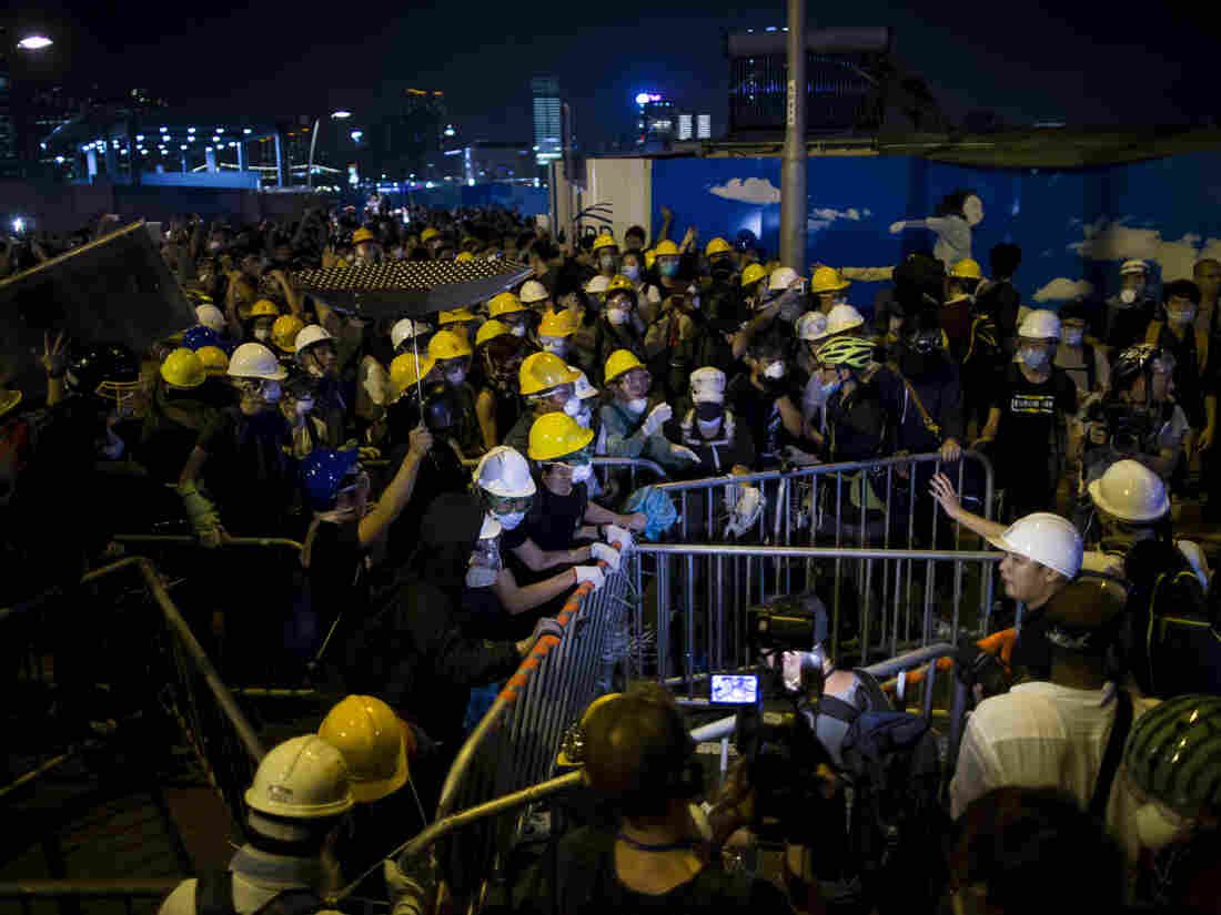 Pro-democracy protesters set up a new roadblock close to the chief executive office in Hong Kong late Sunday.