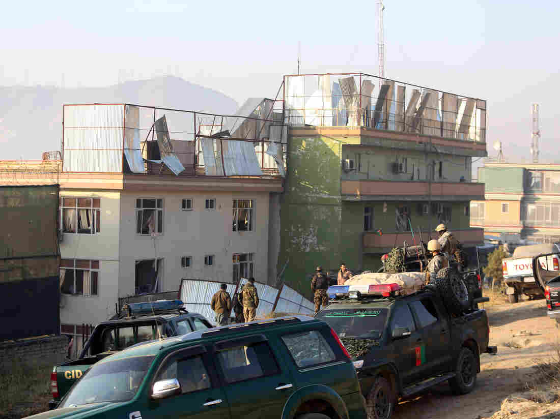 Afghan security forces inspect the site of an attack in Kabul, Afghanistan, on Friday — one of several in recent days that appears to signal a major upsurge in Taliban violence in the city.
