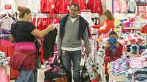 Shoppers Manuel Orellano, middle, with his daughter Marcela, left, and her son Manuel, 6, shop for children's clothing at JCPenney at Glendale Galleria shopping mall in Glendale, Calif, on Friday.