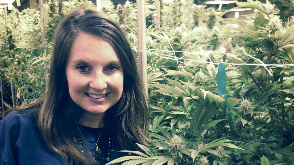 Brooke Gehring, CEO of Patients Choice and Live Green Cannabis, stands in one of her company's grow houses in Denver. (Kirk Siegler/NPR)