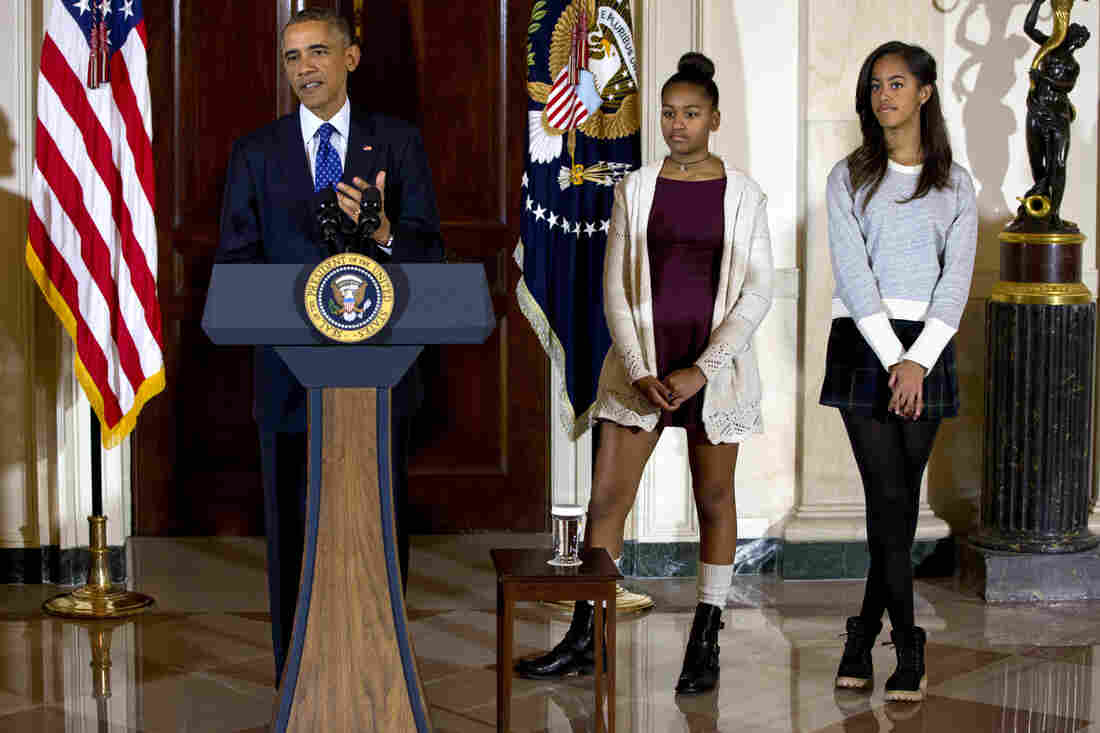 President Obama, joined by his daughters Malia, right, and Sasha, center, speaks at the White House, in Washington during the presidential turkey pardon ceremony on Wednesday.