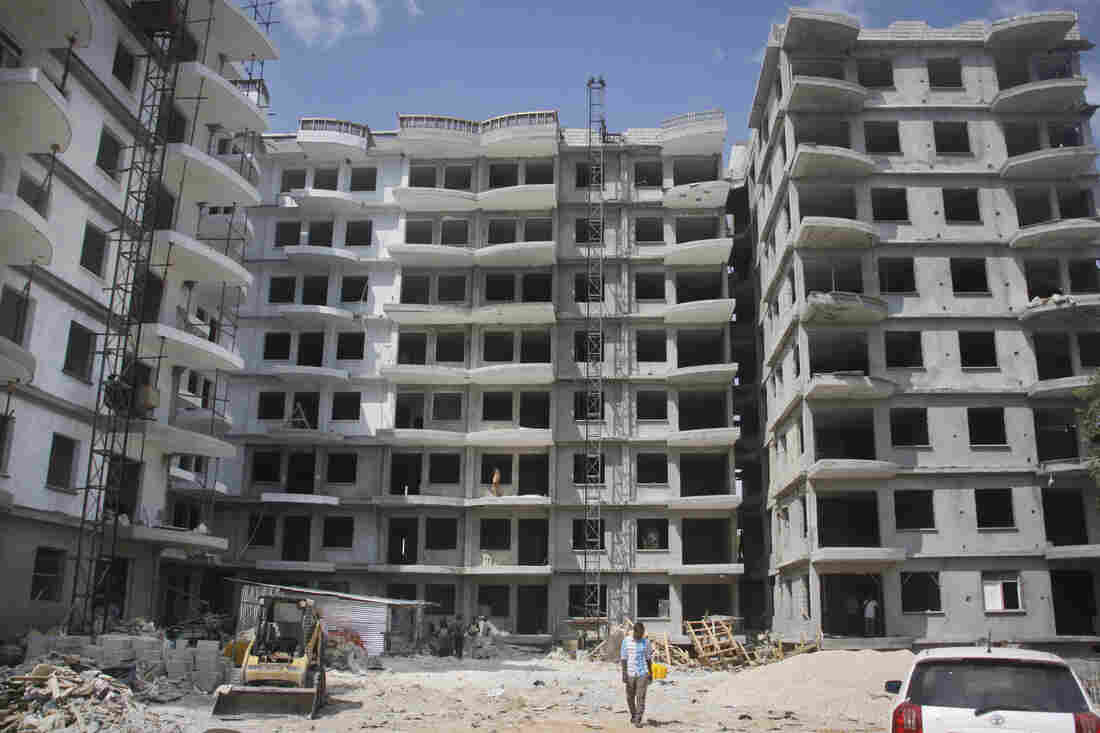 A Somali man walks in front of a high-rise apartment building under construction in Mogadishu on Nov. 4. Somalia, along with North Korea, is seen as the most-corrupt country in the world, according to the Corruption Perception Index released today by Transparency International.