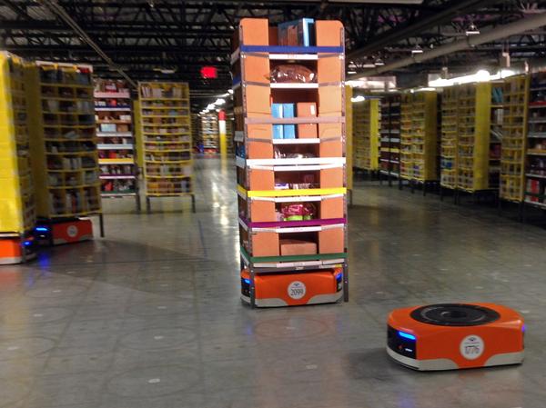 Kiva robots maneuver around one of Amazon's newest distribution centers on Sunday in Tracy, Calif.