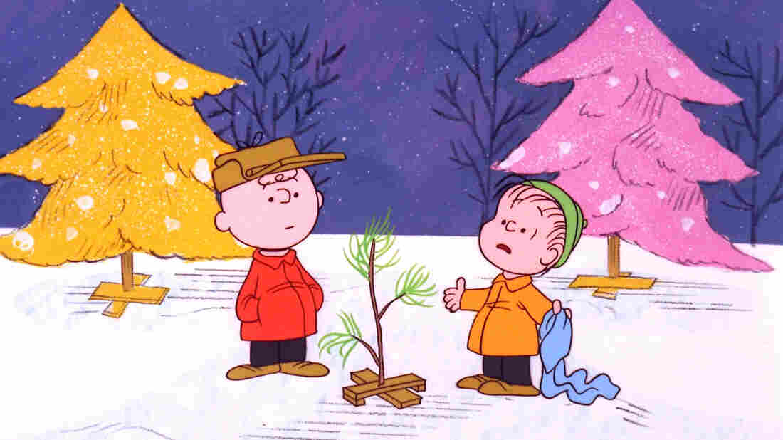 """Charlie Brown and Linus pick out a scrawny tree in A Charlie Brown Christmas, a TV special based on the """"Peanuts"""" comic strip by Charles M. Schulz. The beloved show is airing for the 50th year Tuesday."""