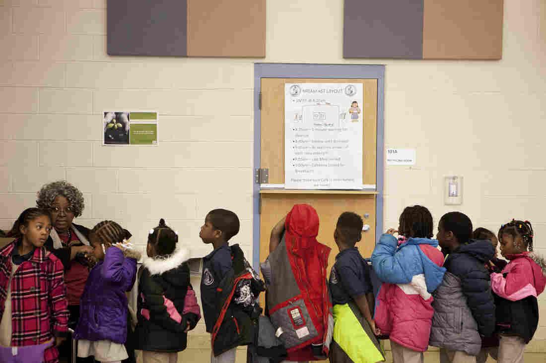 Kids line up to leave the lunchroom at Walker-Jones.