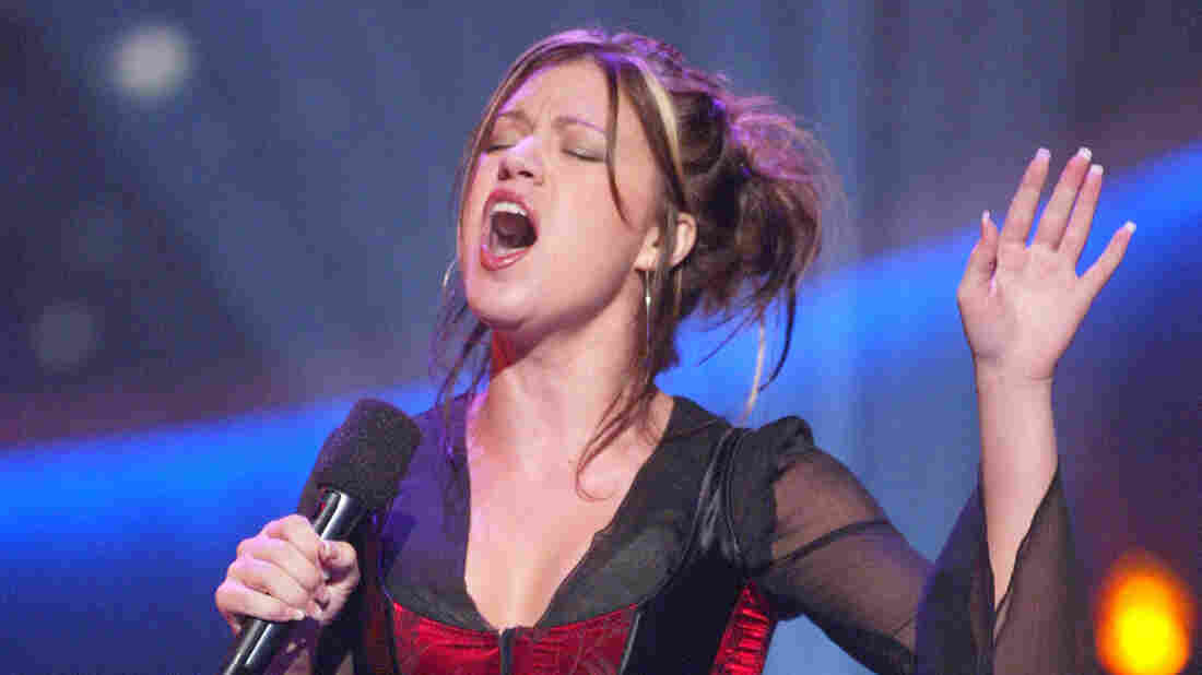Kelly Clarkson performs during an American Idol broadcast in 2002.