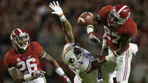 Alabama defensive back Nick Perry (right) breaks up a pass on Auburn wide receiver D'haquille Williams (center) as Alabama defensive back Landon Collins looks on during the second half of the Iron Bowl NCAA college football game Saturday in Tuscaloosa. Alabama won 55-44.