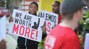 A new minimum wage was approved Tuesday in Chicago, where fast food workers and activists demonstrated outside McDonald's downtown restaurant this summer.