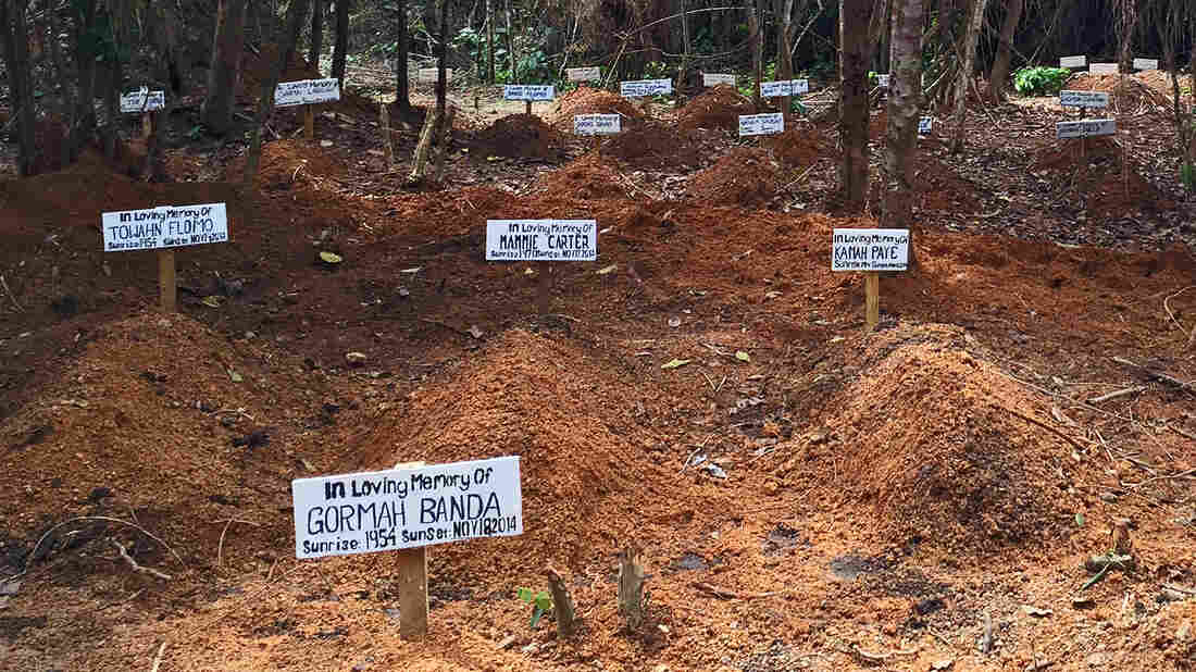 Each day, a nurse comes to this clearing outside Taylortown, Liberia, to sing a song of mourning, preparing the space for the next burial. So far nearly 100 people are interred here.