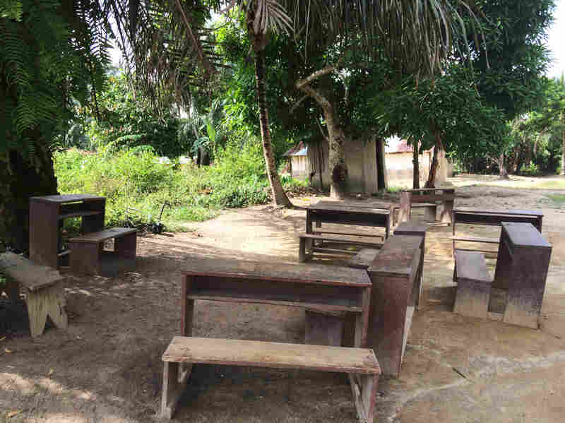 Wooden benches sit at the spot where Stanley's son died of Ebola.