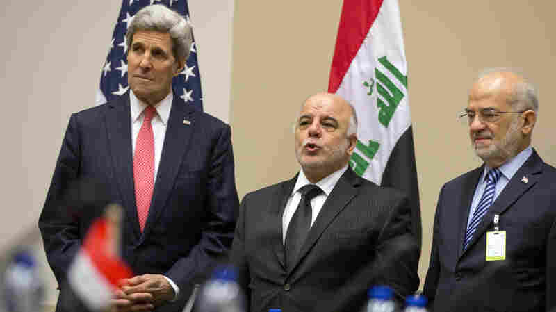 Secretary of State John Kerry, left, Iraqi Prime Minister Haider al-Abadi, center, and Iraqi Foreign Minister Ibrahim al-Jaafari prior to a round table meeting of the global coalition to counter the Islamic State.