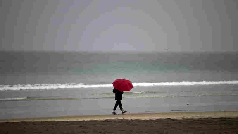 A woman walks on the beach at La Jolla Shores in San Diego on Tuesday.