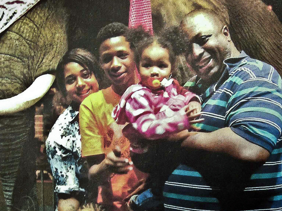 Eric Garner (right) poses with his children. A grand jury has decided not to indict a New York police officer over Garner's death in July. (Family photo via National Action Network/AP)