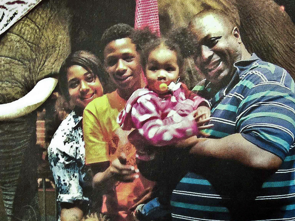 Eric Garner (right) poses with his children. A grand jury has decided not to indict a New York police officer over Garner's death in July.