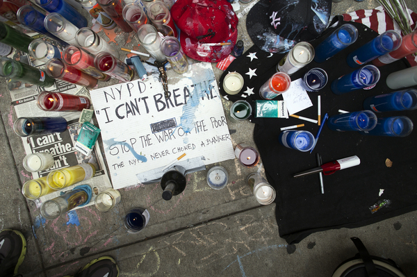A memorial for Eric Garner rests on the pavement near the site of his death, on July 19, in Staten Island, N.Y.