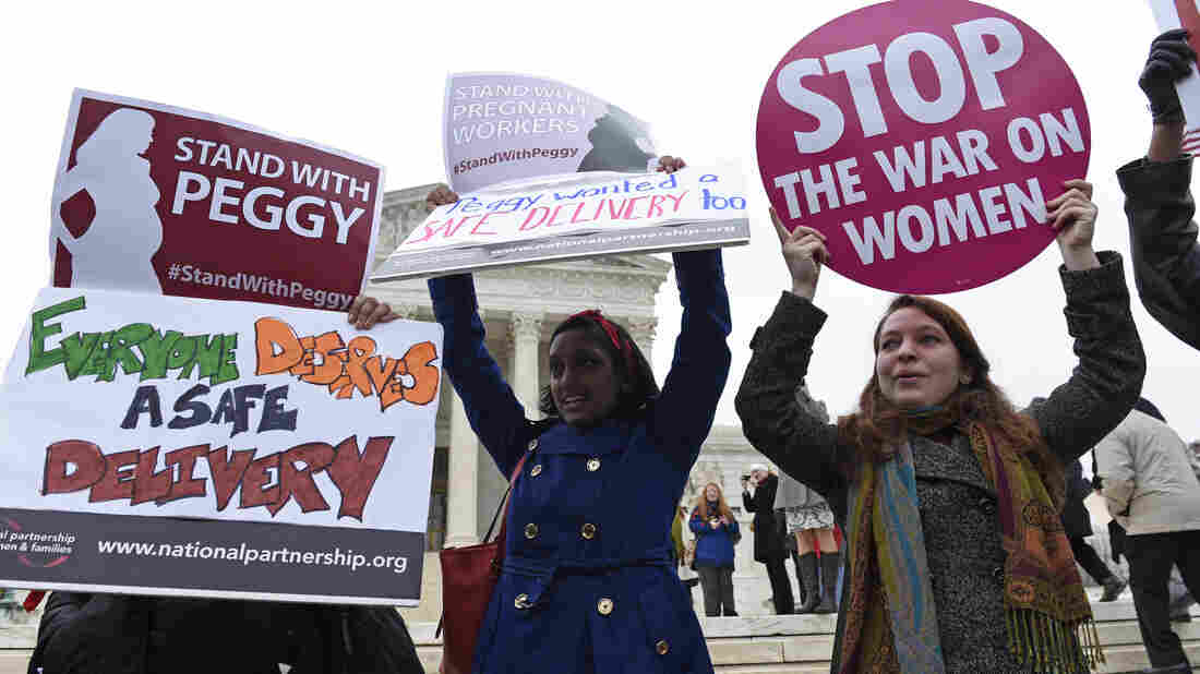 Supporters of Peggy Young attend a rally outside the Supreme Court Wednesday.