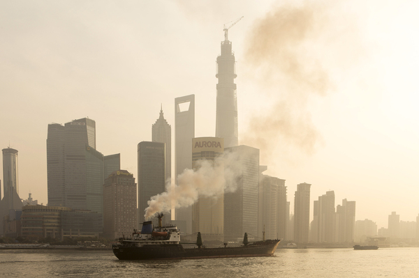 A ship sails up the Huangpu River as heavy smog engulfs the city on Dec. 25 in Shanghai, China. Both China and the U.S. recently announced targets for cutting greenhouse gas emissions over the next 15 years.