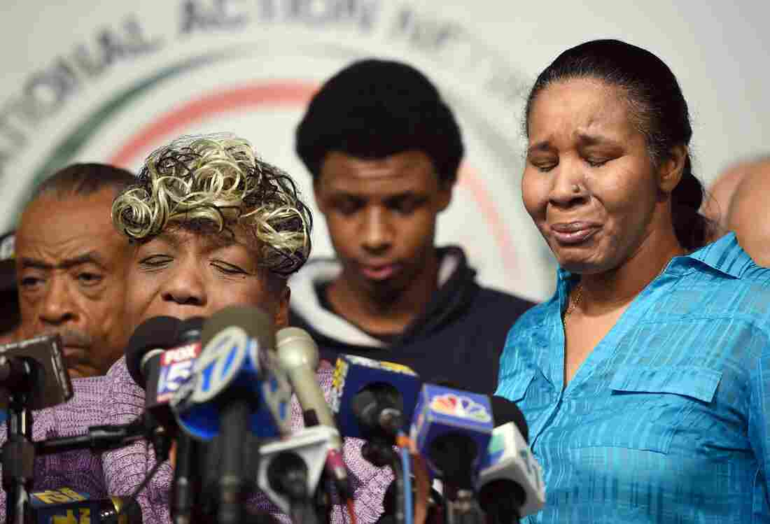 Gwen Carr, mother of Eric Garner, speaks at a news conference with his widow, Esaw Garner, and others, including the Rev. Al Sharpton (left) on Wednesday.