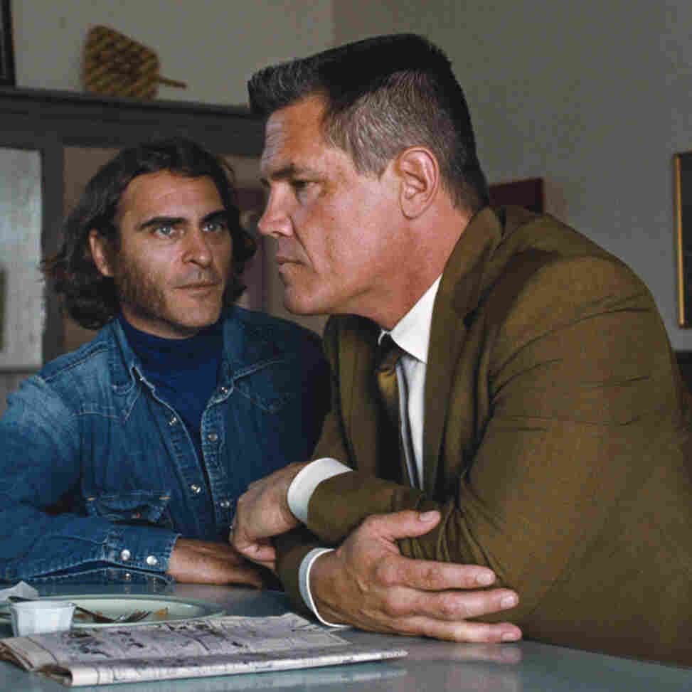 """In Inherent Vice, Joaquin Phoenix (left) plays a burned-out hippie private eye, while Josh Brolin is a Los Angeles Police Department detective --€"""" Lt. Detective """"Bigfoot"""" Bjornsen --€"""" who is investigating a murder and kidnapping case."""