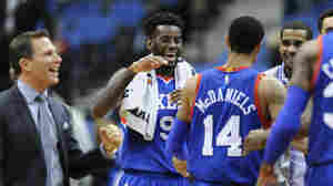 Philadelphia 76ers forward JaKarr Sampson congratulates guard K.J. McDaniels during the fourth quarter of Wednesday's NBA basketball game against the Minnesota Timberwolves.