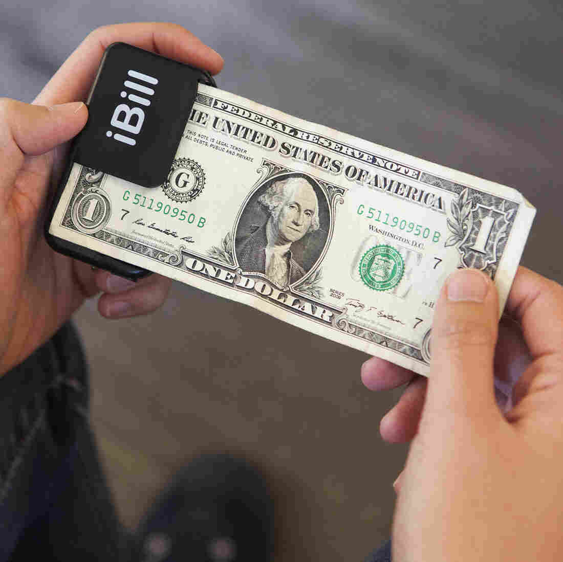 "After scanning a $1 bill with iBill, a speaker announces, ""one dollar."""