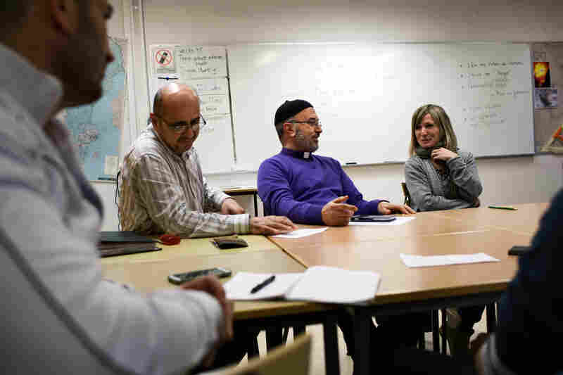 Saad Shamoon Moshi (left), Father Stefan Ayoub, and Swedish teacher Marie Silén in the Swedish language class for immigrants. Even by Swedish standards, Sodertalje has been exceptionally welcoming to refugees.
